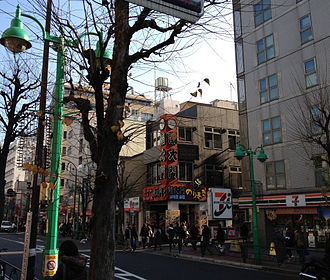 Ōkubo, Tokyo - Downtown Shin-Ōkubo during daytime. Note the trilingual signs across the street.