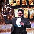 Sidharth Shukla holding Bigg Boss 13 Trophy.jpg