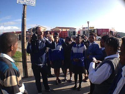 Sinenjongo 12A High Schoolers and Victor Grigas in Joe Slovo Park.jpeg