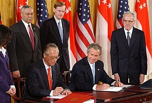 Goh Chok Tong - Goh and U.S. President George W. Bush signing the US-Singapore Free Trade Agreement in the White House, 6 May 2003.