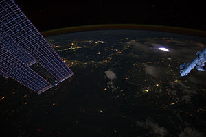 Sprite (lightning) - A sprite seen from the International Space Station (top right, faint red above the lightning).