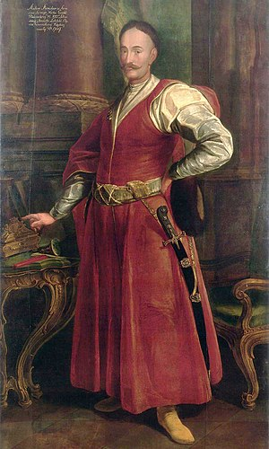 Kontusz - Polish noble Stanisław Antoni Szczuka (1652-1710)  in a representative national Polish outfit. A red kontusz tied with a pas kontuszowy. Underneath a żupan with a low collar. Left hand holds a fur cap with a low band. Characteristic hair and moustache. Unknown artist.