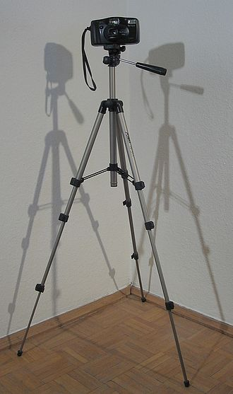 Tripod (photography) - A camera mounted on an aluminum tripod