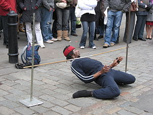 Limbo (dance) - A man participating in limbo in London.