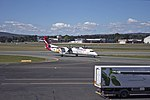 Sunstate Airlines 'QantasLink livery' (VH-QOI) Bombardier Dash-8 Q402 taxiing at Canberra Airport.jpg