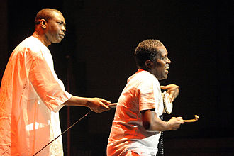 Mbalax - A talking-drum player with Youssou N'Dour