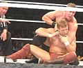 Ted DiBiase headlock on Daniel Bryan.jpg