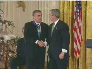 George Tenet - President Bush awarding the Presidential Medal of Freedom to Tenet on December 14, 2004