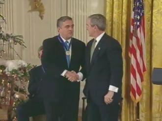 George Tenet - President Bush awarding the Presidential Medal of Freedom to Tenet on December 14, 2004