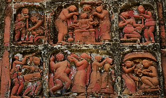 Terracotta Panel of KrishnaLila on wall of Pancharatna temple on the eastern side of temple cluster at Moukhira in Purba Bardhaman district.jpg