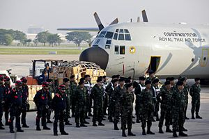 Humanitarian response to the 2015 Nepal earthquake - Royal Thai Army personnel and rescue worker briefing before boarding a C-130H at Donmuang Airport.