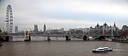 The Thames passes by some of the sights of London, including the Houses of Parliament and the London Eye