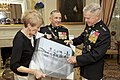 The 35th Commandant of the Marine Corps, Gen. James F. Amos, right, and Marine Corps First Lady Bonnie Amos, left, participate in a gift exchange with Gen. George J. Flynn, center, at the Home of the Commandants 130509-M-LU710-107.jpg