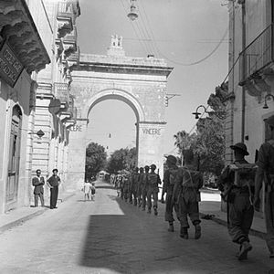 Italian Campaign (World War II) - British infantry marching through the town of Noto, Sicily, 11 July 1943.