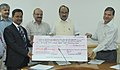 The Chairman, NCCF, Shri Virendra Singh presenting a dividend cheque for the year 2010-2011 to the Minister of State (Independent Charge) for Consumer Affairs, Food and Public Distribution, Professor K.V. Thomas.jpg