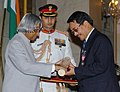 The President, Dr. A.P.J. Abdul Kalam presenting Padma Shri to Prof. Laltluangliana Khiangte, reputed scholar, at investiture ceremony in New Delhi on March 29, 2006.jpg