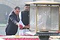 The President of the Republic of Tajikistan, Mr. Emomali Rahmon paying floral tributes at the Samadhi of Mahatma Gandhi, at Rajghat, in Delhi on December 17, 2016.jpg