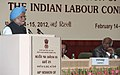 The Prime Minister, Dr. Manmohan Singh addressing the 44th session of Indian Labour Conference, in New Delhi on February 14, 2012. The Union Minister for Labour and Employment, Shri Mallikarjun Kharge is also seen (1).jpg