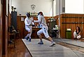The bout between the fencers Stamatis and Aris Koutsouflakis at Athenaikos Fencing Club.jpg