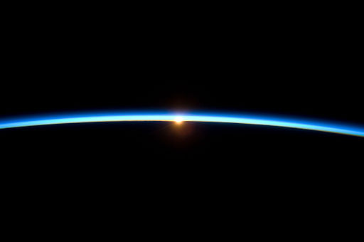 Thin Line of Earth's Atmosphere and the Setting Sun