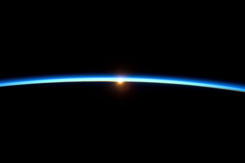 Thin Line of Earth's Atmosphere and the Setting Sun.jpg