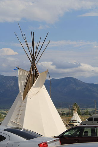 Confederated Salish and Kootenai Tribes of the Flathead Nation - Tipi and Mission Mountains at 2015 Arlee Celebration Pow Wow