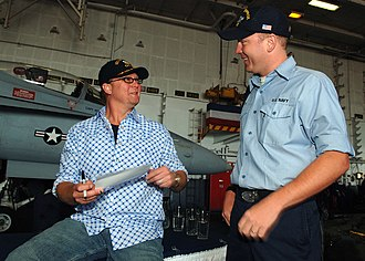 Tracy Lawrence - Lawrence signs an autograph for a sailor aboard the USS Enterprise (CVN-65), May 2007