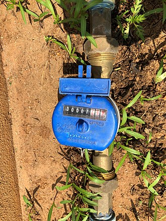 Water metering - A typical water meter in an apartment complex in Bengaluru, India. Note that the meter provides reading in Kilolitres