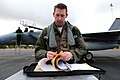 U.S. Air Force Capt. Aaron Schuett, an F-15C Eagle aircraft pilot and chief of mobility with the 493rd Fighter Squadron, checks forms prior to a training mission during the Tactical Leadership Program (TLP) 130118-F-BH151-092.jpg