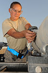 U.S. Air Force Senior Airman Melissa Bissinger, a munitions systems specialist with the 451st Expeditionary Maintenance Squadron Munitions Flight, fastens an arming wire to a bomb at Kandahar Airfield 100823-F-OL185-739.jpg