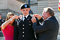 U.S. Army 2nd Lt. Dakota Lawler, center, with the Kentucky Army National Guard, is pinned by Ashley Holley, left, his fiancee, and Neil Lawler, his grandfather, during a commissioning ceremony Sept 140927-Z-GN092-139.jpg