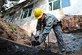 U.S. Army Spc. Aleksandr Popov, an interior electrician with the 176th Engineer Company, 96th Troop Command, Washington Army National Guard, builds a foundation form at a school during Khaan Quest 2013 130727-M-MG222-001.jpg