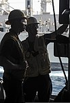 U.S. Navy Boatswain's Mate 3rd Class Jacob Brill, left, and Boatswain's Mate 2nd Class Aloys Marcano check the fueling station on the aircraft carrier USS Nimitz (CVN 68) during a replenishment at sea 130807-N-AZ866-013.jpg