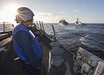 U.S. Navy Boatswain's Mate Seaman Kalani Williams, assigned to the guided missile destroyer USS Mason (DDG 87), mans a replenishment station as the ship approaches the fast combat support ship USNS Arctic 130729-N-PW661-002.jpg