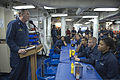 U.S. Navy Cmdr. Robert Alpigini, left, the commanding officer of the guided missile destroyer USS Stout (DDG 55), addresses the crew during a commemoration ceremony honoring Dr. Martin Luther King Jr 140118-N-UD469-677.jpg