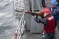 U.S. Navy Gunner's Mate 3rd Class Kasey Hayes prepares to fire a shot line from the guided missile frigate USS Ford (FFG 54) during a replenishment at sea with the dry cargo ship USNS Carl Brashear (T-AKE 130507-N-QY316-146.jpg