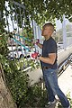 U.S. Navy Lt. Cmdr. Ulysses L. Ubalde, the command chaplain assigned to the amphibious assault ship USS Kearsarge (LHD 3), trims a tree during a volunteer project at the Guardians of the Bay Foundation in Eilat 130516-M-BS001-004.jpg