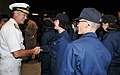 U.S. Navy Vice Chief of Naval Operations Adm. Mark E. Ferguson, left, congratulates recruits after a capping ceremony at Recruit Training Command at Naval Station Great Lakes, Ill., Sept 120921-N-IK959-189.jpg