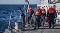 U.S. Sailors aboard the guided missile destroyer USS Truxtun (DDG 103) participate in a man overboard drill in the Atlantic Ocean Dec. 12, 2013 131212-N-EI510-000.jpg