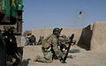 U.S. Special Forces Soldiers with Combined Joint Special Operations Task Force-Afghanistan prepare to fire a mortar round toward an identified enemy fighting position during a clearance operation in Bahlozi 140101-A-LW390-263.jpg