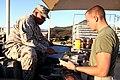 U. S. Marine Master Gunnery Sgt. Socorro Hernandez with Combat Logistics Regiment 2, 2nd Marine Logistics Group, brings hot chow to his Marines in the field during Enhanced Mojave Viper (EMV), on Marine Corps 120920-M-KS710-004.jpg
