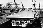 USS Intrepid (CVA-11) in a dry dock at the Norfolk Naval Shipyard, in 1954.jpg