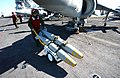 US Navy 031215-N-0111R-038 A sailor aboard the amphibious assault ship USS Wasp transports MK-82 500 pound bombs across the flight deck for loading on an U.S. Marine Corps AV-8B Harrier.jpg