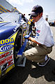 US Navy 040429-N-6501M-003 A NASCAR race official measures the wheel specifications on the No. 14 Navy-sponsored Chevy Monte Carlo.jpg