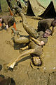 US Navy 040518-N-9693M-011 Midshipmen wrestle in a mud pit to recover a photograph as part of the competition in Sea Trials.jpg