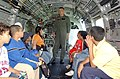 US Navy 040527-N-4936C-112 U.S. Marine Corps Sgt. George Watson, assigned to Marine Medium Helicopter Squadron Seven Seven Four (HMM-774), talks to children inside a CH-46E Sea Knight.jpg