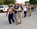 US Navy 041123-N-9563N-506 Members assigned to the Naval Support Activity (NSA) Bahrain Emergency Response Team, lead contaminated victims of a simulated Chemical, Biological, and Radiological attack to be treated.jpg