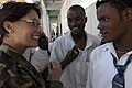 US Navy 050307-N-0411D-008 U.S. Navy Capt. Ann Adcook of Indianapolis, Ind., compares her rosary to that of a student at Lycee Bicentenaire Universite in Gonaives, Haiti.jpg