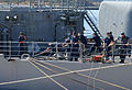 US Navy 050608-N-0780F-004 Crewmembers aboard the guided missile cruiser USS Philippine Sea (CG 58) handle mooring lines as they arrive at the Marathi Pier Facility in Greece for a port visit.jpg