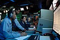 US Navy 051221-N-4154B-001 Operations Specialists man their workstations in the Combat Direction Center (CDC) aboard the Nimitz-class aircraft carrier USS Theodore Roosevelt (CVN 71).jpg